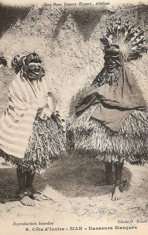 Masked dancer, western Ivory Coast, circa 1910. Dan or Guere ethnic group. Vintage postcard photographer G. Kante.
