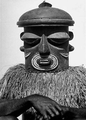 A Bayaka man wearing a mask for a ritual in the Belgian Congo. 1947. Photograph by Eliot Elisofon.