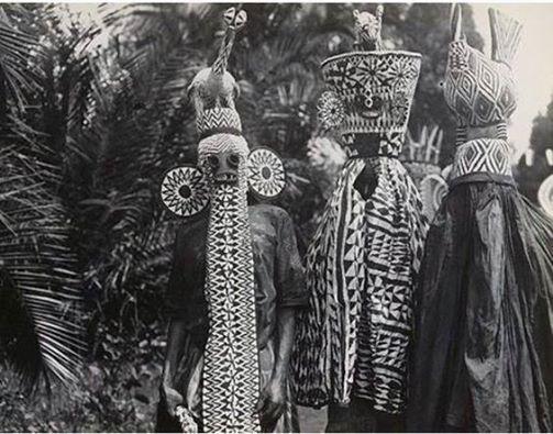 Bameleke costumed ritual dancers, Cameroon, circa 1930's. Photographer unknown.
