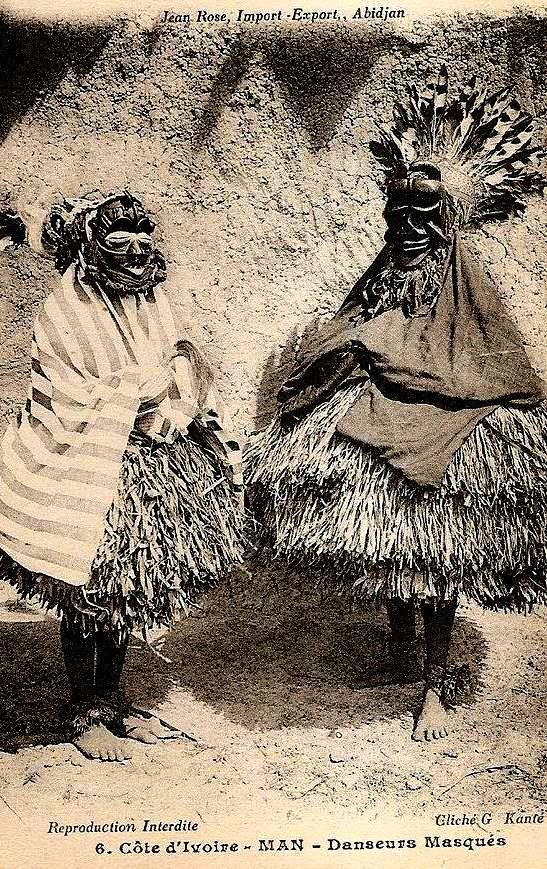 Masked dancer, western Ivory Coast, circa 1910. Dan or Guere ethnic group. Vintage postcard photographer G. Kante.