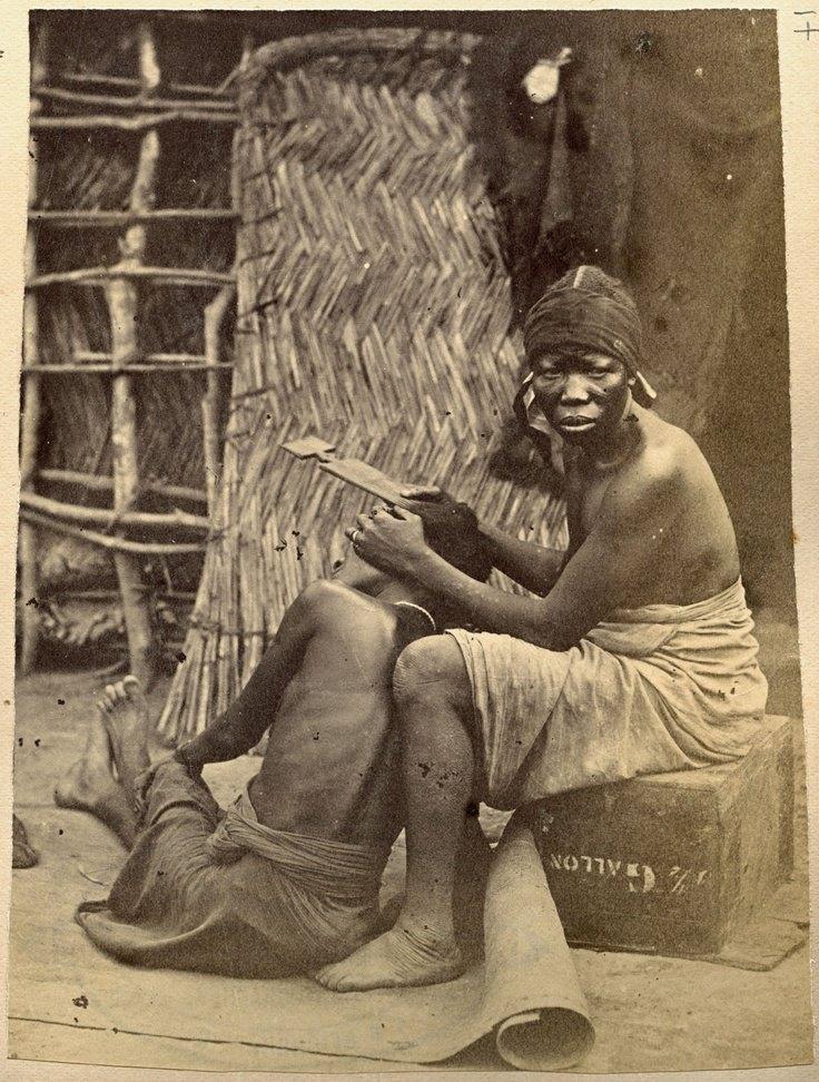 Fanti Hairdresser, Ghana, circa 1910.